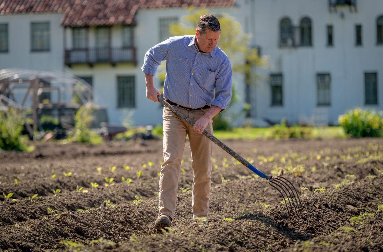 Patrick working in a field
